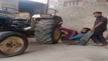 Haciendo piernas con un tractor