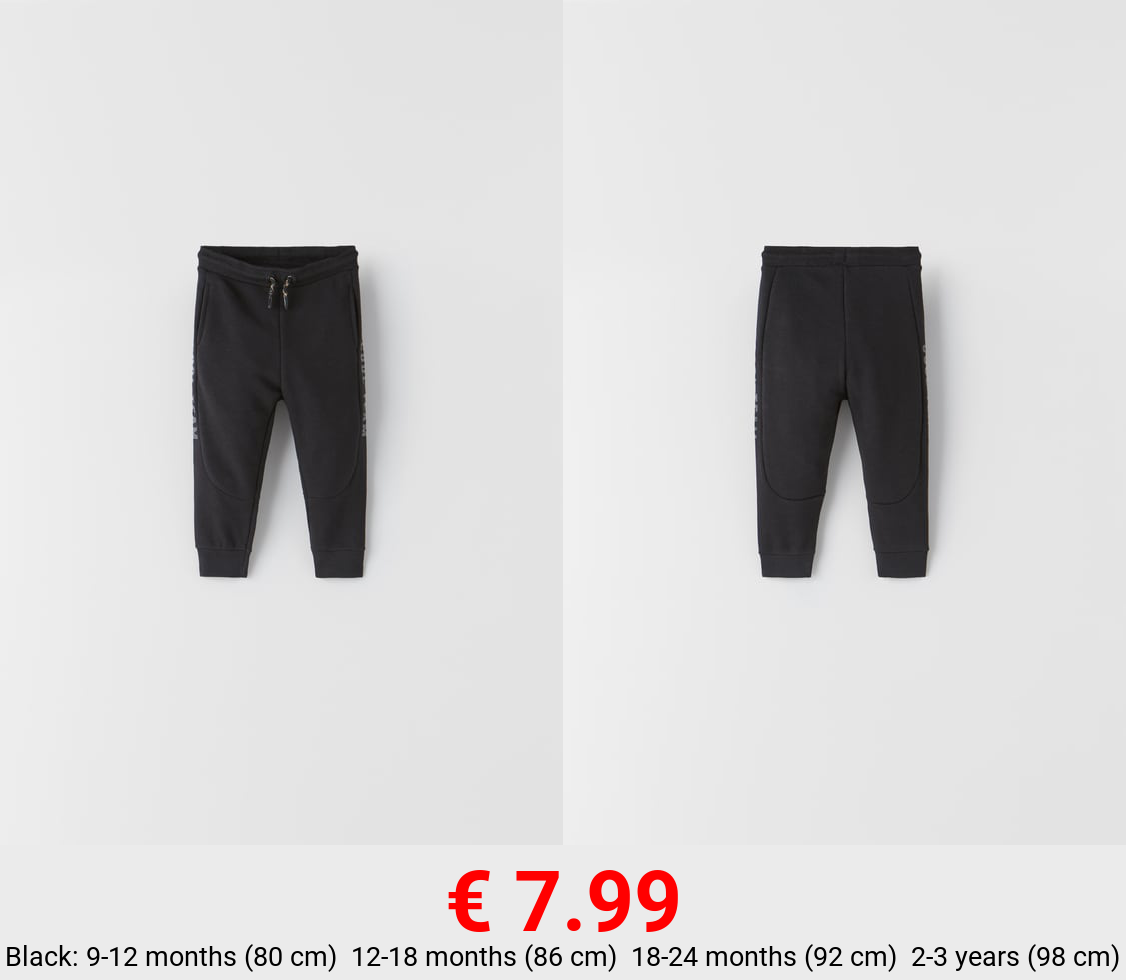 TEXT TROUSERS